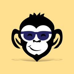 Head of black monkey with glasses, cartoon on light brown background,