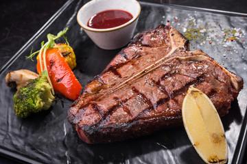 Grilled T-bone steak with vegetables