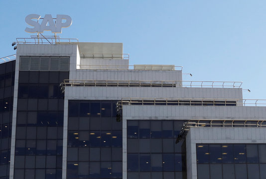 A view shows a sign with the logo of SAP software company on the roof of an office building in Moscow
