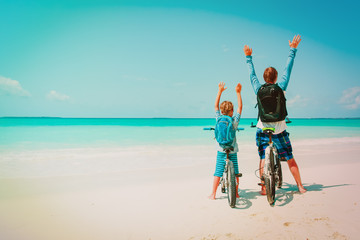 happy father and son and biking on beach