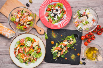 Food set with greek salad, seafood with mussels, caprese, vegetables