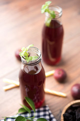 Kokum Sharbat, Juice or Sherbet OR summer coolant drink made up of Garcinia indica with raw fruit, served in a glass with mint leaf. selective focus