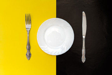Lunch time concept. Plate with knife and fork