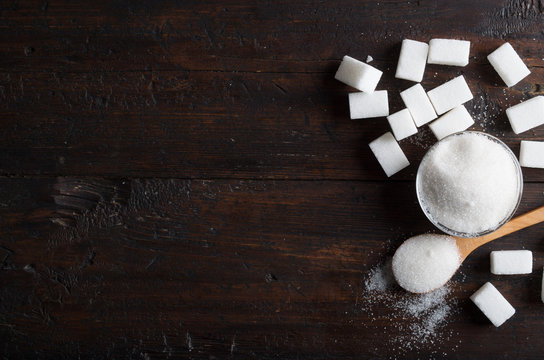white sugar on wood table