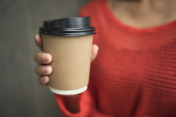 hand holding coffee paper cup. mock up for branding.