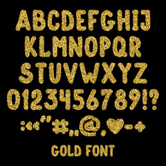 Gold glitter english alphabet, punctuation marks and numbers. Shiny font isolated on black background.