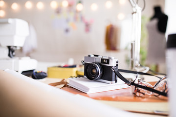 A camera on a table in interior of a studio, startup business.