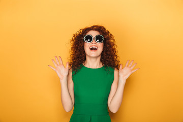 Close up portrait of an excited curly redhead woman