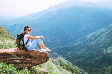 Woman enjoy with beautiful view on mountains and valley in Ella, Sri Lanka, Little Adam Peak