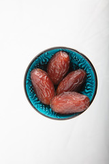 Dried dates (fruits of date palm)on white background