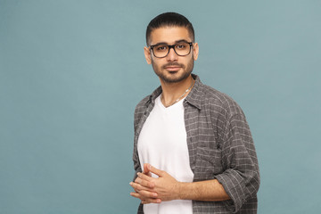 Portrait of handsome man with black glasses in casual style looking at camera and smiling.
