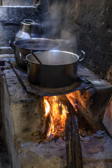Traditional Brazilian food being prepared on old and popular wood stove