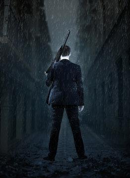 Businessman gangster shooting with gun