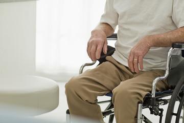 Senior man sitting in a wheelchair.