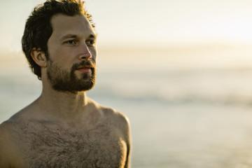 Man at beach.