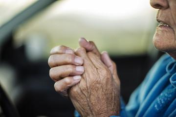 Elderly man sitting in car.