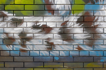 Abstract colorful (green, blue, white, brown) brick wall as background, texture