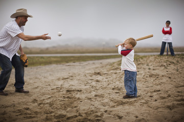 Father and sons playing baseball