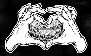 Two hands making heart sign with landscape scene