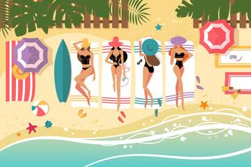 Cute girls sunbathing on beach