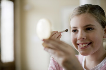 Girl putting on make-up