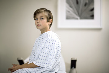 Portrait of a young boy waiting for an examination in a doctor's office.