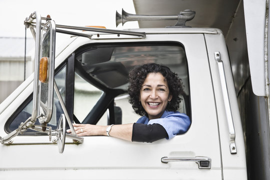 Female truck driver with her delivery truck