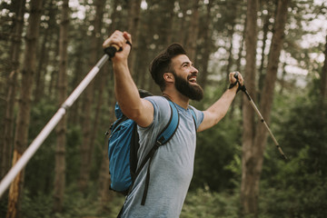 Young bearded hiker in mountain