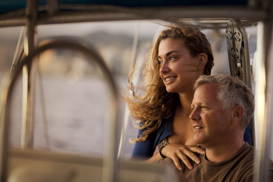 Couple looking at view while relaxing on boat.
