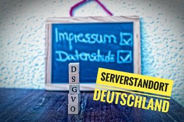 Bauklötze mit der Aufschrift DSGVO in englisch GDPR Impressum und Datenschutz und Serverstandort Deutschland (Imprint and Data Protection and Server Location Germany)