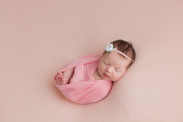 newborn girl. newborn photo shoot. newborn baby in pink on pink background