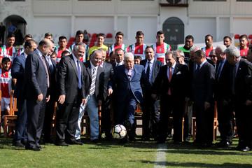 Palestinian President Mahmoud Abbas kicks a ball at Club Deportivo Palestino soccer club in Santiago