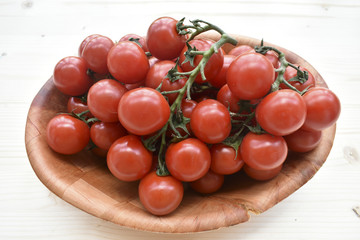 Fresh Biologic Tomatos on Wooden Background