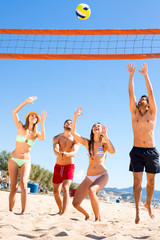 Group of people playing beach volley