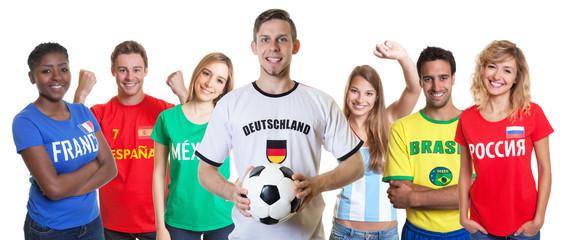 Deutscher Fussball Fan mit Ball und anderen Fans