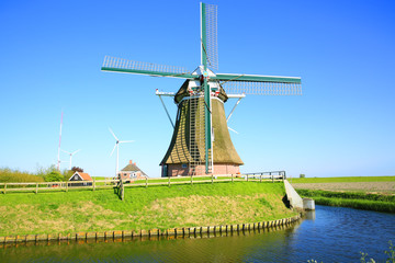Poster de jardin Artistique The historic windmill Goliath in Friesland, North Sea coast, Province Groningen, the Netherlands