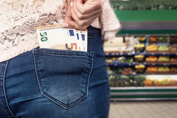 Shopping conception with euro banknotes in jeans pocket