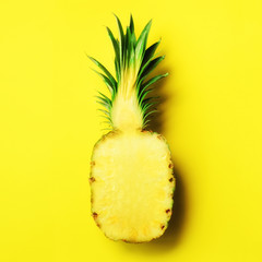 Half of sliced pineapple on yellow background. Top View. Copy Space. Bright pattern for minimal style. Square crop. Pop art design, creative concept.