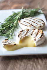 Grilled Camembert cheese with fresh rosemary