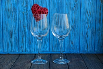 two empty glass glasses with a red heart