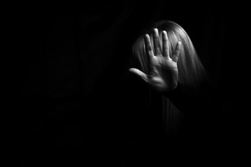 Woman's hand showing STOP gesture. Violence concept.