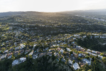Aerial view of hillside and canyon homes in the Hollywood Hills above the San Fernando Valley in Los Angeles, California.