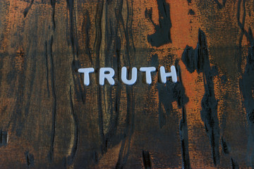 the word truth written in white block letters