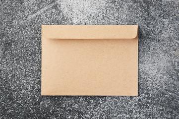 Kraft envelope on gray baqground