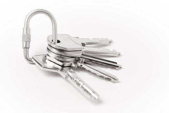 Key ring with two keys over white background. Rent