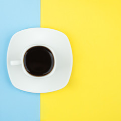 Minimal flat lay concept of white coffee cup on vivid background with copy space, stylish set, isolated