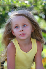 A close up portrait of a beautiful young girl with blue eyes