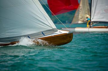 Classic sailing boats racing at a regatta at lake constance