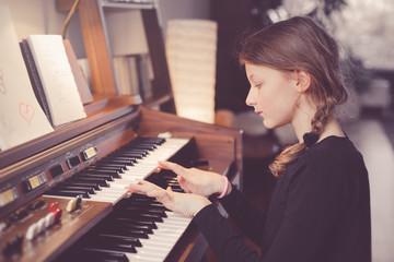 Young girl playing organ