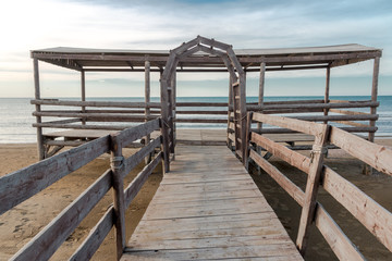 Wooden bridge leading to seaside.